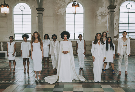 Solange, sister Beyonce and mom Tina Knowles pose with other family members in official wedding portrait for Vogue.