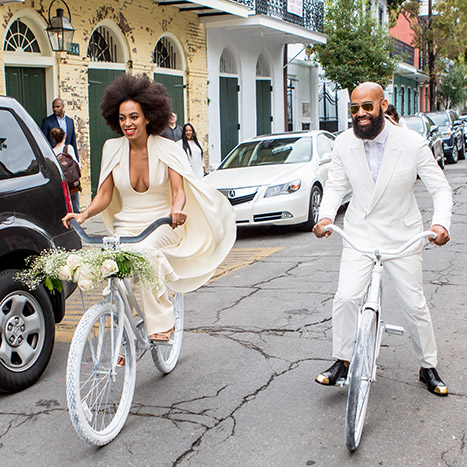 Solange & Alan riding bikes through the streets of New Orleans to their Wedding Venue, the Marigny Opera House. Credit: Josh Brasted/WireImage